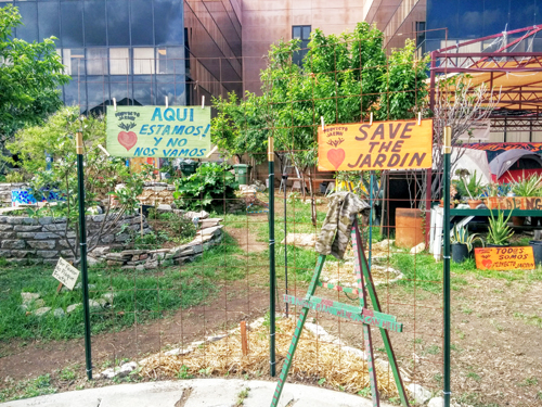 Signs protesting displacement can be seen all over the Boyle Height's community garden. (EGP photo by Jacqueline Garcia)