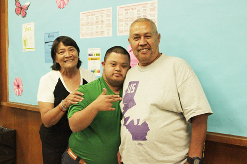 Josefina Blancas, left, and her husband Epifanio Sanchez take their son Fredy Sanchez, center, to the STAR program offered in Bell Gardens. (EGP photo by Nancy Martinez )