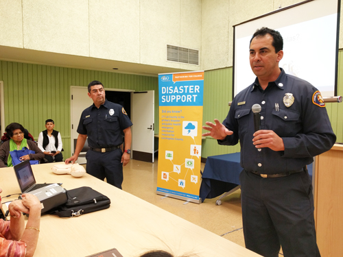 Members of Los Bomberos Association demonstrated to residents how to perform CPR during the PrepareAthon event at Centro Maravilla. (EGP photo by Jacqueline Garcia)