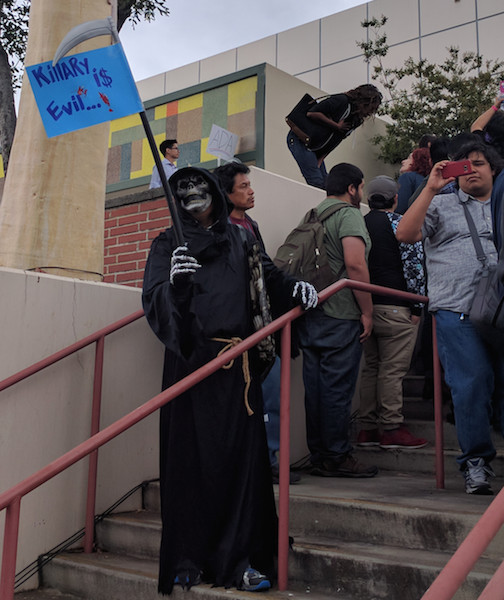 People gathered outside of the ELAC auditorium to protest against Hillary Clinton. (EGP photo by Jacqueline Garcia)