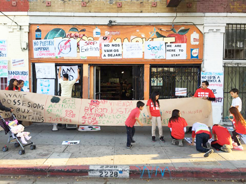 Supporters of the OK Market gathered Friday evening to post signs against gentrification in Boyle Heights. (Courtesy of Timo Saarelma)