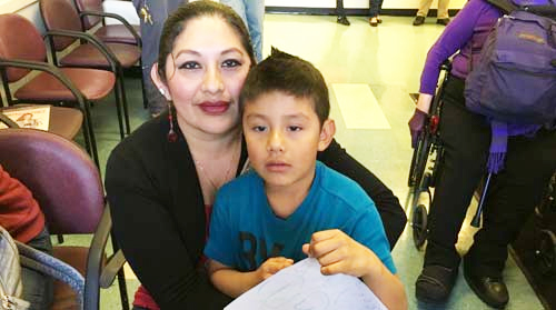 Teresa Lopez with her U.S.-born child, said she hopes to enroll her Mexico-born daughter, age 15, into the new Health For All Kids Program.  (Photo courtesy Jesse Melgar)