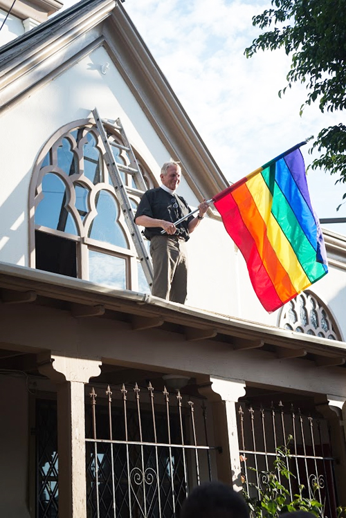For the first time ever the rainbow flag was raised above the 120-year-old Episcopal Church on Altura Street. (Courtesy of TWLM)