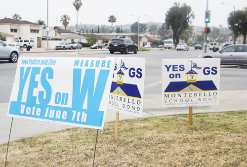 Election signs for Measures on the June 7 election cover the lawn of a Montebello home. (EGP photo by Nancy Martinez )