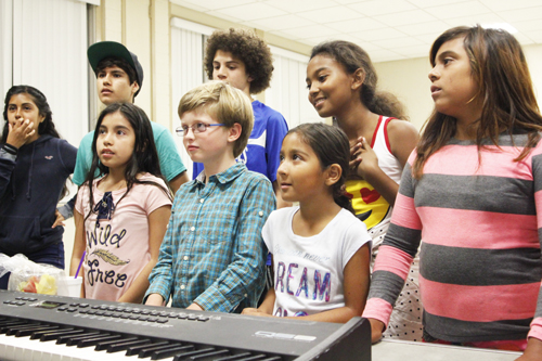 Young singers with Heroes of Dreams strengthen their vocal cords during a music lesson in Bell Gardens. (EGP photo by Nancy Martinez)