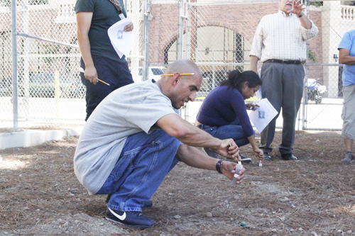 A man collects samples of dirt at L.A. Trade Tech Monday during a training to prepare for a lead sampling technician position. (EGP photo by Nancy Martinez)