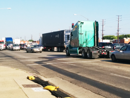 Large trucks overflow into the streets surrounding the I-5 and 710 freeways in Commerce, creating gridlock traffic throughout the day. (EGP photo archive)