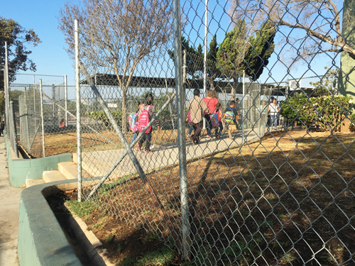 An area near the entrance of Lorena Street Elementary was fenced off after high levels of lead were found in the soil. (EGP photo by Nancy Martinez)