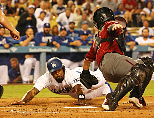Howie Kendrick dives to beat out the tag on Wednesday night to tie the game at 1 before taking the lead for good. (Photo by Fred Zermeno)