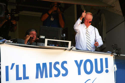 "Vince Scully gives the fans thumbs up and thanks them once again by singing ""Take Me Out To The Ball Park"" in the seventh inning. (Photo by Fred Zermeno)"