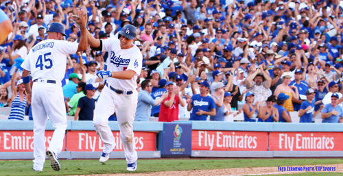 The crowd erupts in cheers as Corey Seager rounds third base to tie the game in the ninth inning, keeping hope alive for a fourth consecutive Western Division Title. (Photo by Fred Zermeno)