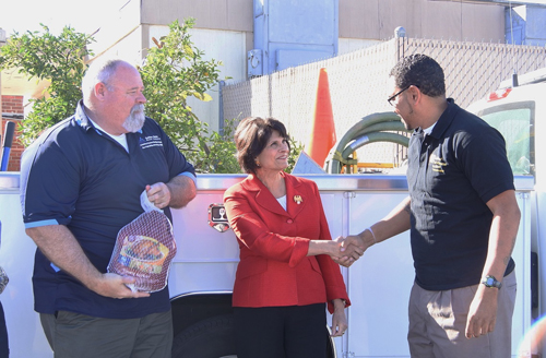 Congresswoman Lucille Roybal-Allard (center) greets a representative from Soledad Enrichment Action, which received donated turkeys as part of Operation Gobble. (Office of Congresswoman Lucille Roybal-Allard)