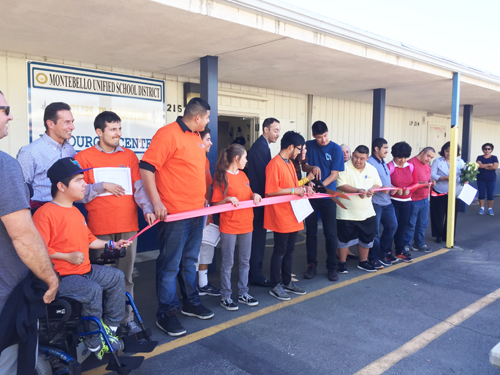 Students attending special education at the Laguna Nueva School site, join MUSD administrators to celebrate the grand opening of the Families in Transition Resource Center. (MUSD)