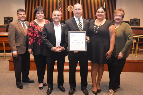 Jason Stinnett, center, is recognized by the Commerce City Council Nov. 15. Photo: City Of Commerce