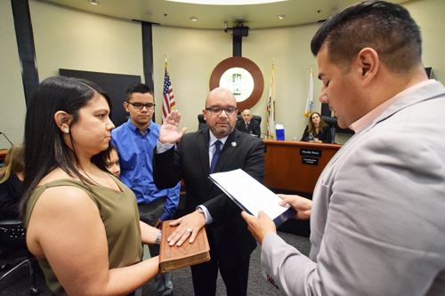 Bell Gardens Mayor Pedro Aceituno, center, takes the oath of office after his re-election to the city council earlier this year. (EGP Photo Archive)
