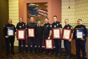 From left:) Vernon Officer Carlos Ourique, Fire Captain Steve Agon, Fire Captain Dave Moore, Victim Cristobal Cisneros, Firefighter Matt Holtzendorff, Firefighter Troy Milano, Fire Paramedic Jeff Shuster, and Vernon Officer Richard Velasquez. (Photo courtesy of Vernon Police Dept.)