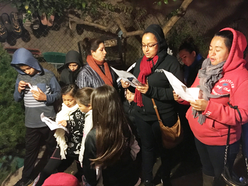 With their children close by, a group of mothers sing traditional songs during las posadas festivities Dec. 16 in Bell Gardens. (EGP photo by Nancy Martinez)