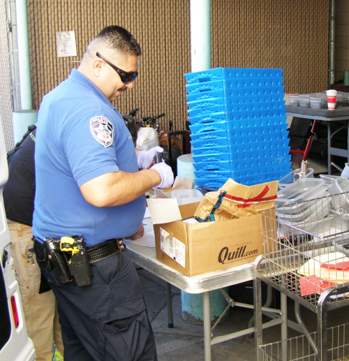 Pictured: Bell Gardens Police personnel dismantle guns and rifles for safe disposal. (City of Bell Gardens)