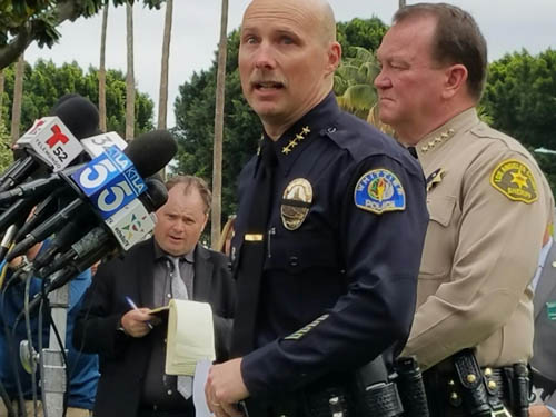 An emotional Whittier Police Chief Jeff Piper told reporters today that the officer killed was Keith Wayne Boyer. Sheriff Jim McDonnell (back) lamented new laws that allow the early release of convicted criminals. (EGP photo by Fred Zermeno)