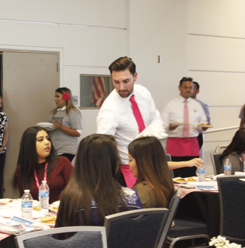 Assemblymember Ian Calderon serves lunch to the young women at the Inaugural Young Latinas Empowerment Conference. (EGP photo by Nancy Martinez)