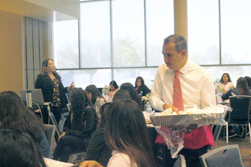 Sen. Tony Mendoza serves lunch to young Latinas during the Inaugural Young Latinas Empowerment Conference. (EGP photo by Nancy Martinez)