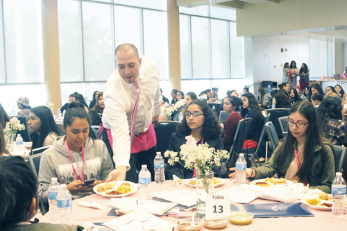 MUSD Boardmember Edgar Cisneros serves lunch to young Latinas during the Inaugural Young Latinas Empowerment Conference. (EGP photo by Nancy Martinez)
