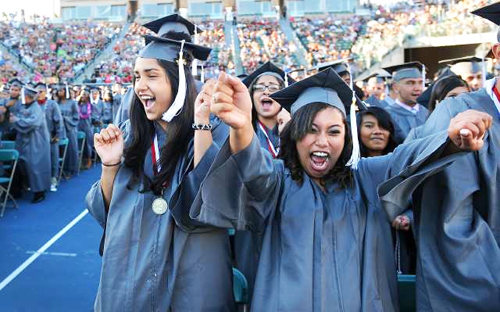 CARSON, CALFORNIA JUN 27, 2012-Jessica Espinoza, left, and Karla De Leon celebrate during Fremont High School's graduation at the Home Depot Center in Carson Wednesday June 27th, 2012. This is the largest graduating class ever at Fremont High. The school is two years into a frequently painful restart, during which most teachers did not return. But the new staff has embraced the mission, supporters say, and the school has benefited from district and community attention after decades of neglect. . (Wally Skalij/Los Angeles Times)
