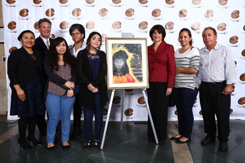 "First Place winner Rebeka Martinez (fifth from left), a senior at Paramount High School, poses with her acrylic, graphite, and charcoal art piece titled ""Light That Never Goes Out"" with Congresswoman Lucille Roybal-Allard (third from right). Rebeka is joined by members of her family, as well as White Memorial Medical Center representative Yuri Casco (far left), Paramount High School Acting Principal Dr. Damon Dragos (second from left) and Rebeka's instructor Juan R. Navarro (far right).(Office of Congresswoman Lucille Roybal-Allard)"