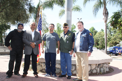 A group of military veterans gathered at the Highland Park Veterans Memorial Wednesday call for Joe Bray-Ali to withdraw over comments he made about flag burning in 2006 on blog post. (Courtesy of Al C. Strange)
