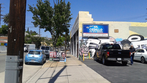A billboard for urging the public to vote for Councilman Gil Cedillo is found next to the campaign office of his challenger Joe Bray-Ali. (Photo by Diana Martinez)