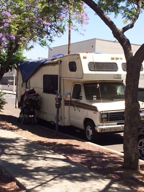 A homeless man parks camper on Avenue 24 in Lincoln Heights. (EGP photo by Gloria Alvarez)