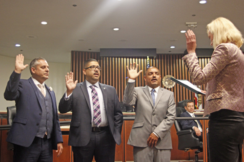 Ivan Altamirano, John Soria and Leonard Mendoza take the oath of office during Tuesday's Commerce council meeting.  (EGP photo by Nancy Martinez)