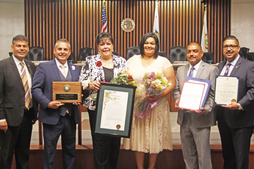 Outgoing councilwoman Tina Baca Del Rio, pictured third from left, was recognized by the new Commerce city council. (EGP photo by Nancy Martinez)