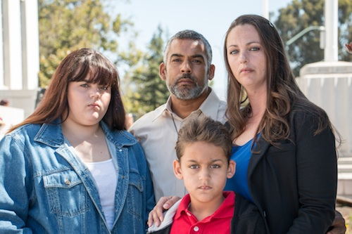 The lawsuit plaintiffs include Rebecca Binsfeld, far right, and her husband, Carlos de Jesus, center, seen here with their kids. Binsfeld suffers from lupus and de Jesus has chronic back pain. (Kim Rescate/SEIU-UHW)