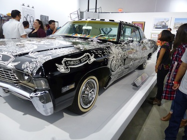 "1968 Chevy Impala, ""El Muertorider,""painted by Artemio Rodriguez & John Jota Leanos, is one of several lowriders on display in ""The High Art of Riding Low,"" a new exhibition that opened June 29 at the Petersen Automotive Museum. (Photo by Oscar Castillo)"