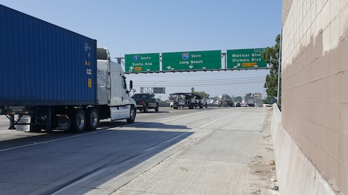 Cities along I-710 corridor say SB1 makes truck emission rules less stringent, increasing the health risk to local east and southeast Los Angeles County residents. (EGP photo by Carlos Alvarez)