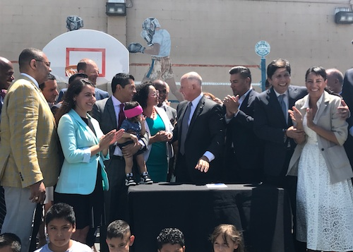 Gov. Jerry Brown in Bell Gardens Wednesday signs AB 617 authored by Assemblymembers Cristina Garcia (D-Bell Gardens), Eduardo Garcia (D-Coachella) and Miguel Santiago (D-Los Angeles).