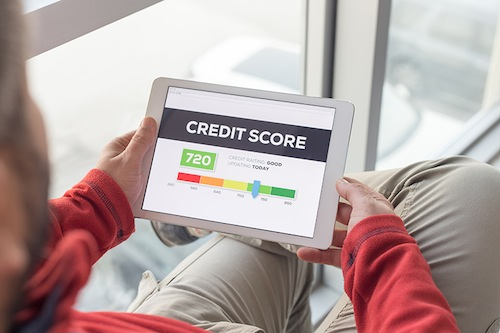 Man working on tablet with Credit Score on screen