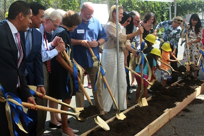 Students, teachers and friends of Dolores Mission in Boyle Heights help break ground on a new facility to house more students. Los Angeles council man Jose Huizar and Assemblyman Miguel Santiago were among those taking part in the ceremony. (EGP photo by Fred Zermeno)