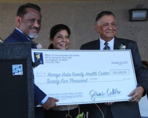 Los Angeles Councilman Gil Cedillo (left), surprises Arroyo Vista CEO Lorraine Estradas (center) and Board Chairman Roger Estrada with a $25,000 donation on Oct. 23. (Photo by Steve Weingart)