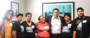 Concerned that the misdemeanor charge for street vending at a city park could lead to the deportation of some immigrants without legal status, Councilman Jose Huizar co-authored a motion with Councilman Mitch O'Farrell to decriminalize the offense. Pictured:  Councilman Huizar (center) meets with street vendor organizers. (Office of Councilman Jose Huizar)