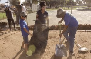 Montebello City Park staff member Ilene Martinez joins St. Benedict Church Cub Scout Pack 0476 member and parent during Beautification Day last Saturday.  (EGP Photo by Carlos Alvarez)