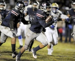 Garfield High School running back Peter Jason Garcia races into the open field in last Friday's game with El Casino Real. (photo by Mario Villegas)