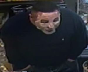 LAPD released images of suspect wearing a mask who is wanted in 6 armed robbers in Eagle Rock and Highland Park. (Courtesy LAPD)