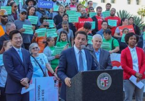 Councilman Jose Huizar (center) and affordable housing advocates at City Hall Wednesday morning called for support for a linkage fee on developers to fund the building of affordable housing. (Photo courtesy Office of Councilman Jose Huizar)